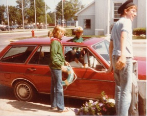 """Almy's family heralding in the dawn of """"Nautical City"""" by docking a Volkswagen in front of the bank in the early 1980s. (Courtesy of Kathryn Almy)"""