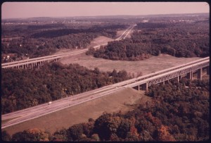 AERIAL_VIEW_LOOKING_NORTHEAST_AT_THE_OHIO_TURNPIKE_OF_THE_1950'S_AND_THE_INTERSTATE_OF_THE_1960'S_AS_THE_HIGHWAYS..._-_NARA_-_558049